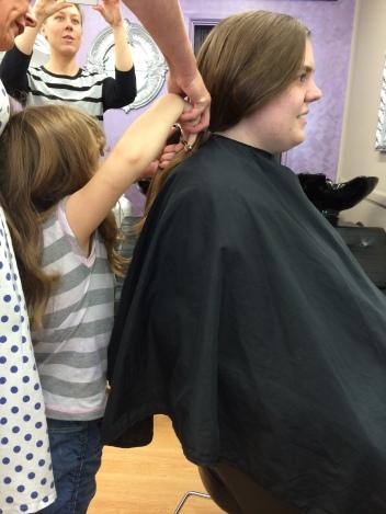 14/4/14 - Chloe helping the hairdresser cut the hair