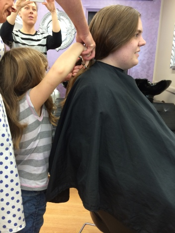 14/4/14 - Chloe helping the hairdresser cut the hair